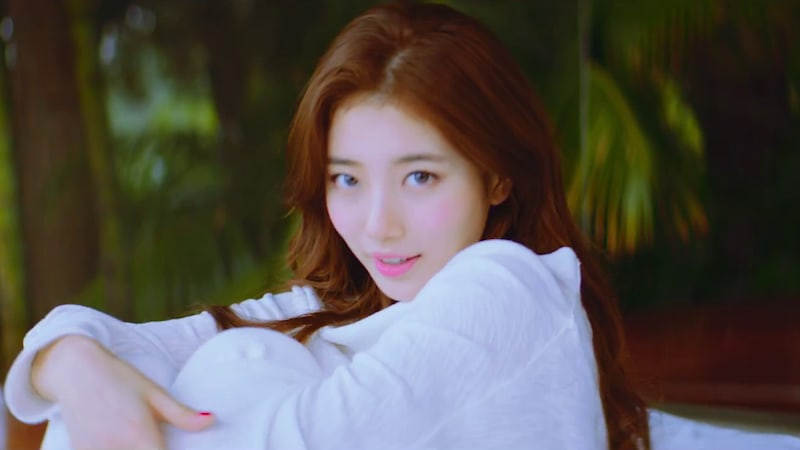 """Watch: Suzy Takes Off On A Sweet """"Holiday"""" In MV For New Title Track"""