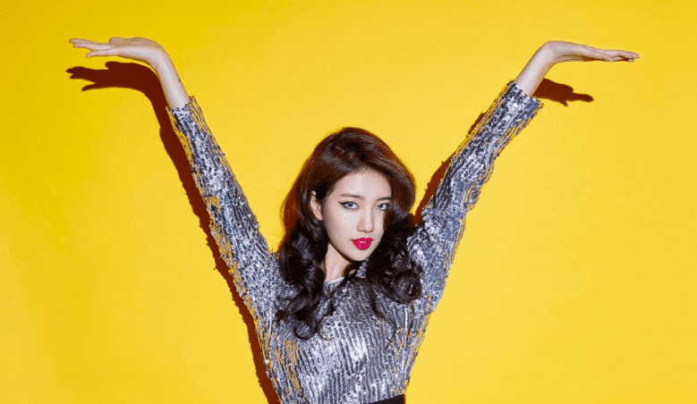 "Watch: Suzy Playfully Says She's Not ""SObeR"" In Latest Colorful MV"