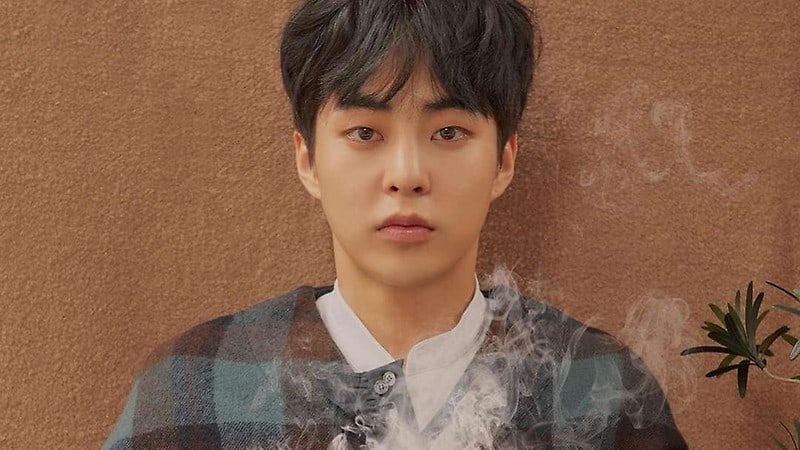 EXO's Xiumin Spotted Happily Showing His Love For 2018 PyeongChang Winter Olympics Goods
