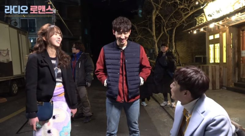 "Watch: ""Radio Romance"" Cast Cheerfully Joke And Deal With Kiss Scenes Behind-The-Scenes"