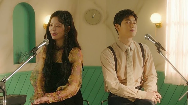 "Watch: EXO's Suho And Jang Jae In Ask ""Do You Have A Moment"" In MV For Duet Track"