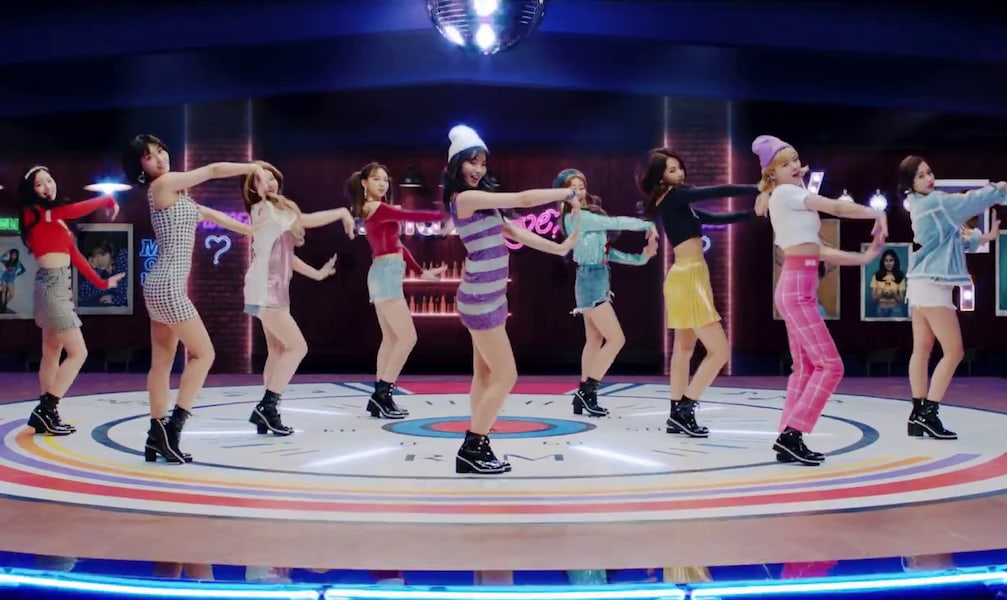 """Watch: TWICE Asks """"What Is Love?"""" In Charming Comeback MV"""