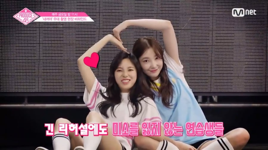 """Watch: """"Produce 48"""" Contestants Eat Chicken And Practice For """"Pick"""