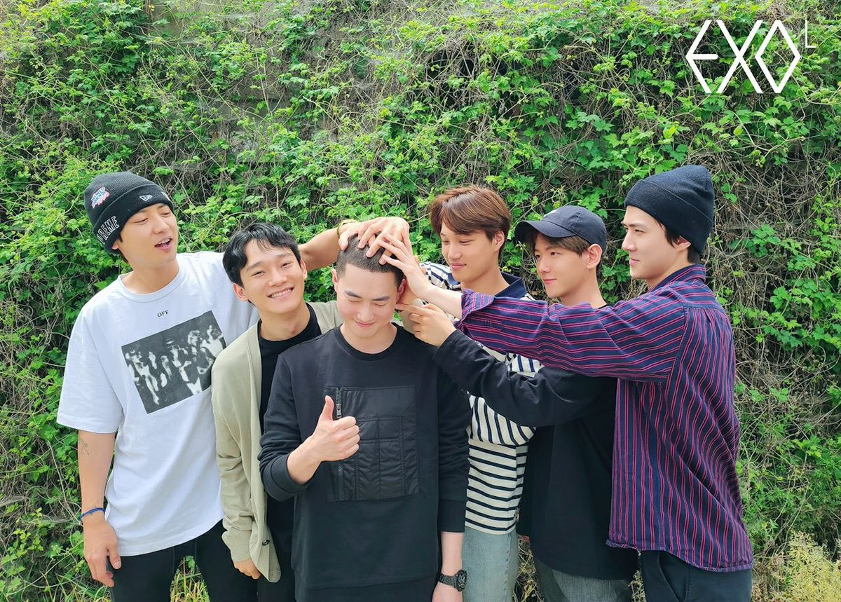 EXO Members Send Off Leader Suho As He Enlists In The Military | Soompi