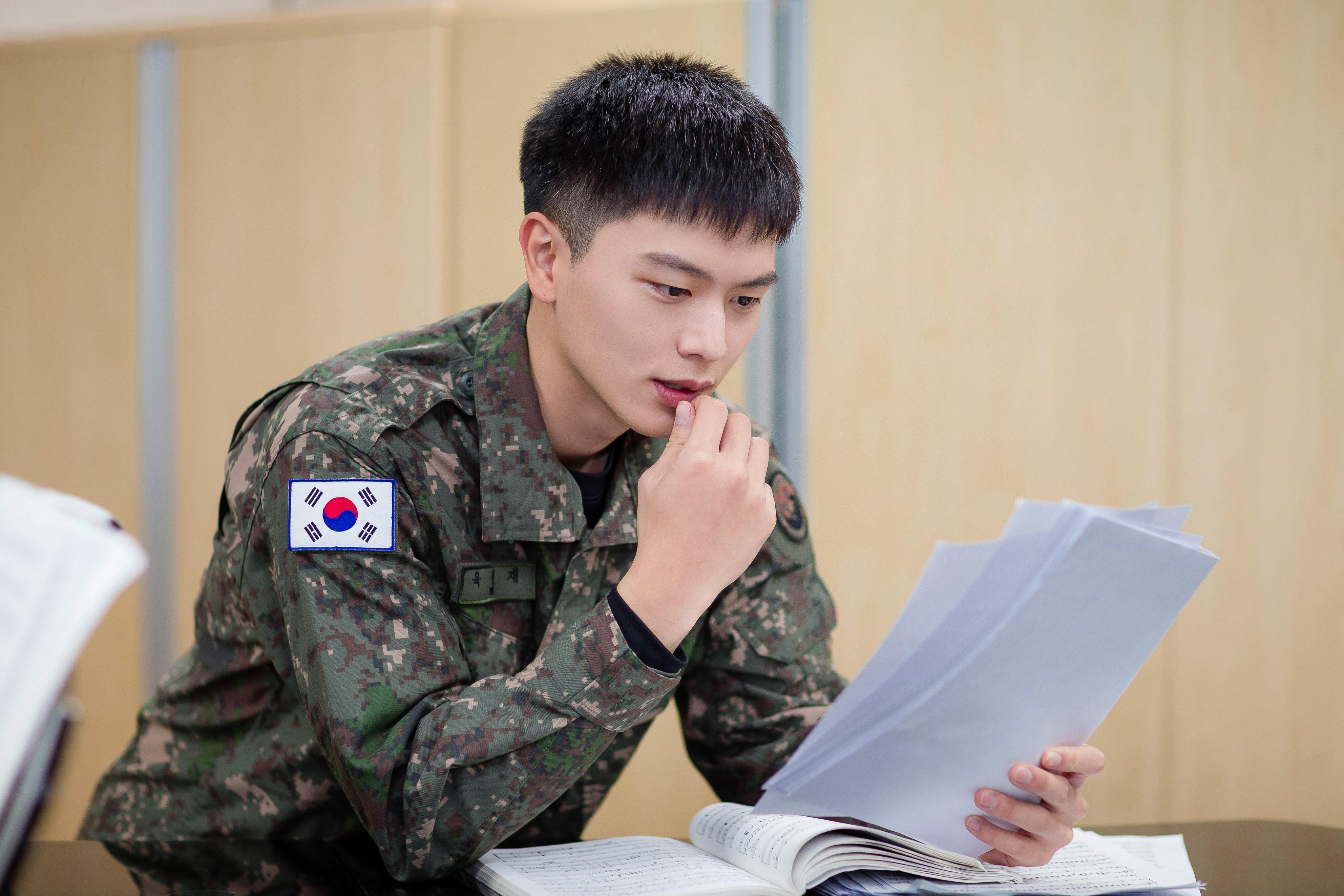 Military Reveals New Photos Of EXO's D.O. And BTOB's Yook Sungjae | Soompi