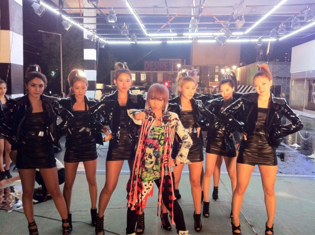 "Minzy Posts a Photo from the ""Ugly"" Music Video Set as well as Hotel in Japan"