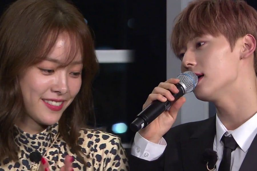 "Hwang Min Hyun de Wanna One hace sonrojar a Han Ji Min cantándole una canción en ""Happy Together 4"""