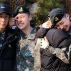 CNU de B1A4 recibe un abrazo y el apoyo de Gongchan mientras finaliza su entrenamiento militar básico